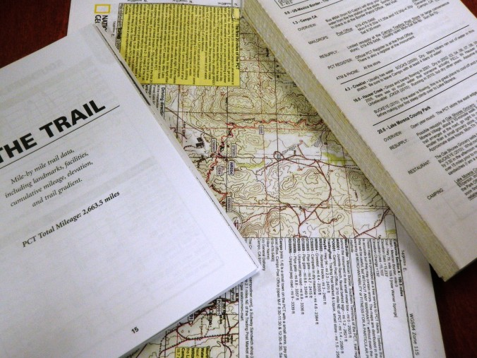 Maps and a strategically-ripped-up guide book.